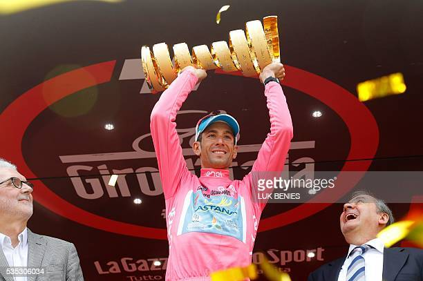 Italy's Vincenzo Nibali celebrates with the trophy on the podium after winning the 99th Giro d'Italia Tour of Italy after the 21th stage from Cuneo...