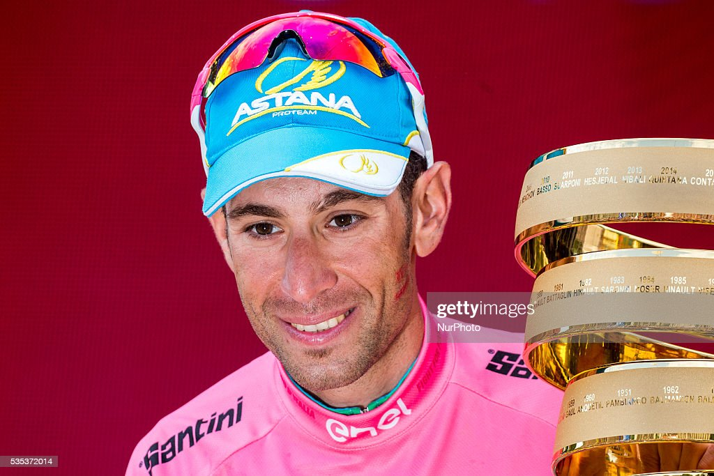 Italy's <a gi-track='captionPersonalityLinkClicked' href=/galleries/search?phrase=Vincenzo+Nibali&family=editorial&specificpeople=770634 ng-click='$event.stopPropagation()'>Vincenzo Nibali</a> celebrates with the trophy on the podium after winning the 99th Giro d'Italia, Tour of Italy, after the 21th stage from Cuneo to Turin on May 29, 2016. Astana's <a gi-track='captionPersonalityLinkClicked' href=/galleries/search?phrase=Vincenzo+Nibali&family=editorial&specificpeople=770634 ng-click='$event.stopPropagation()'>Vincenzo Nibali</a> secured his second Giro d'Italia triumph on Sunday after topping a dramatic 99th edition that saw key rival Steven Kruijswijk agonisingly crash during the final stages. Germany's Nikias Arndt, of the Giant team, celebrated winning the final stage into Turin although it came only after Giacomo Nizzolo, of the Trek team, was stripped of the victory by race judges who ruled the Italian had hampered other riders by deviating from his sprint line.