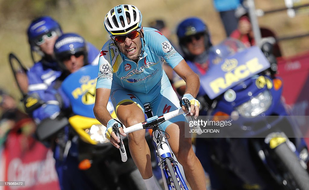 Italy's Vincenzo Nibali (Astana) grimaces as he crosses the finish line on September 2, 2013 after the tenth day of the 68th edition of 'La Vuelta' Tour of Spain, a 186,8km stage between Torre delcampo and Guejar Sierra, Alto de Hazallanas. Horner moved back into the leader's red jersey after winning the 10th stage with Italy's Vincenzo Nibali (Astana) in second and Spaniard Alejandro Valverde third at just over a minute back.