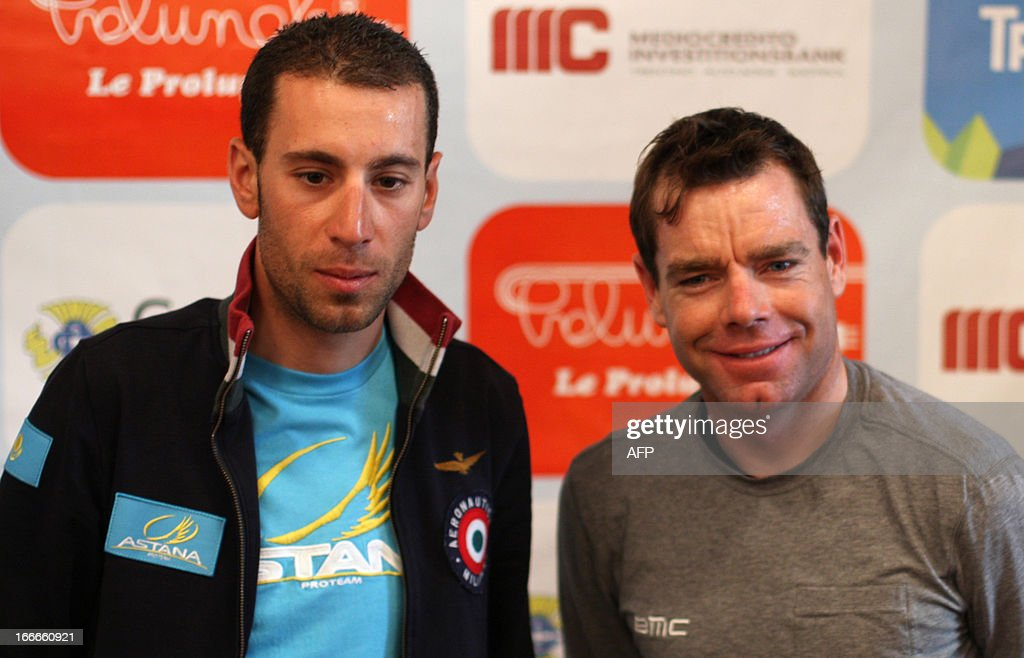 Italy's Vincenzo Nibali (L) of Astana Pro Team and Australia's cyclist Cadel Evans (R) of BMC Racing Team attend cycling road race 'Giro del Trentino' press conference at the city hall in Lienz, on April 15, 2013.