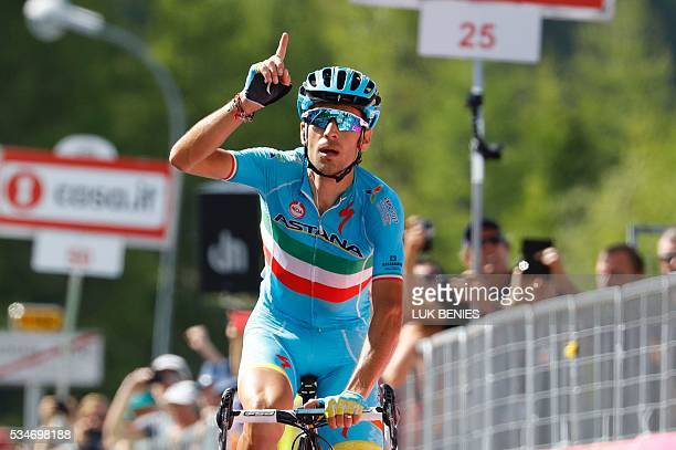 Italy's Vincenzo Nibali of team Astana celebrates as he crosses the finish line to win the 19th stage of the 99th Giro d'Italia Tour of Italy from...