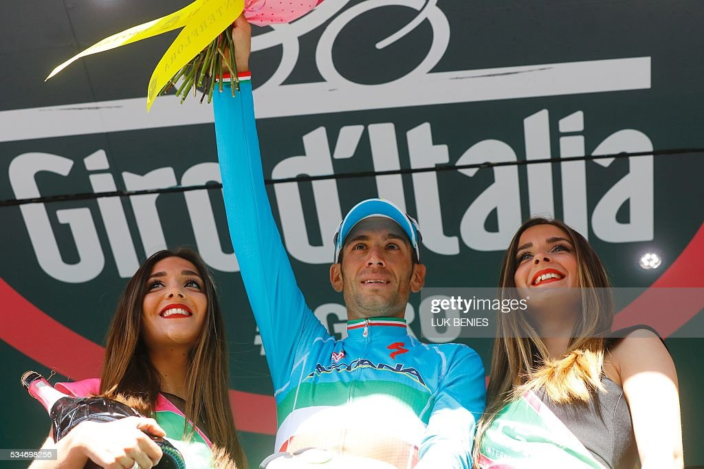 Italy's Vincenzo Nibali of team Astana celebrates on the podium after winning the 19th stage of the 99th Giro d'Italia, Tour of Italy, from Pinerolo to Risoul on May 27, 2016. / AFP / Luk BENIES