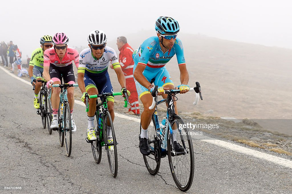 Italy's Vincenzo Nibali of team Astana (R) followed by Colombian cyclist Johan Esteban Chaves of Orica GreenEDGE (C), the pink jersey Dutch Steven Kruijswijk of team (Lotto NL) and Polish cyclist Rafal Majka of Tinkoff team rides during the 99th Giro d'Italia, Tour of Italy, from Pinerolo to Risoul on May 27, 2016. Italy's Vincenzo Nibali of Astana escaped alone to a summit-finish victory today whilst Colombia's Esteban Chaves rode into the pink jersey by coming third on the day. Pre-race favourite Italy's Vincenzo Nibali had been thought to be dead and buried on this Giro after dropping to fifth, but is now just 44seconds off new leader Chavez, in second place, ahead of another mountain stage on Saturday. BENIES