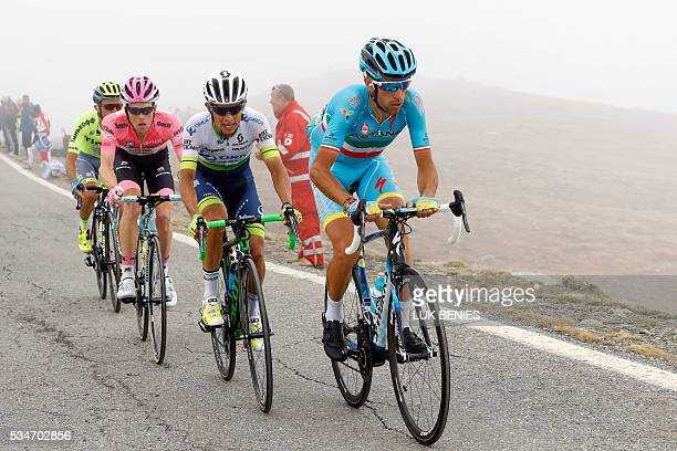 Italy's Vincenzo Nibali of team Astana followed by Colombian cyclist Johan Esteban Chaves of Orica GreenEDGE the pink jersey Dutch Steven Kruijswijk...