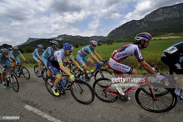 Italy's Vincenzo Nibali rides in the pack with his teammates of the Kazakhstan's Astana Pro cycling team during the 228 km fourth stage of the 67th...
