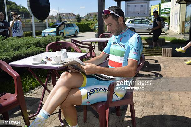 Italy's Vincenzo Nibali the overall leader's yellow jersey reads a newspaper at his hotel during a rest day on July 15 2014 in Besancon eastern...