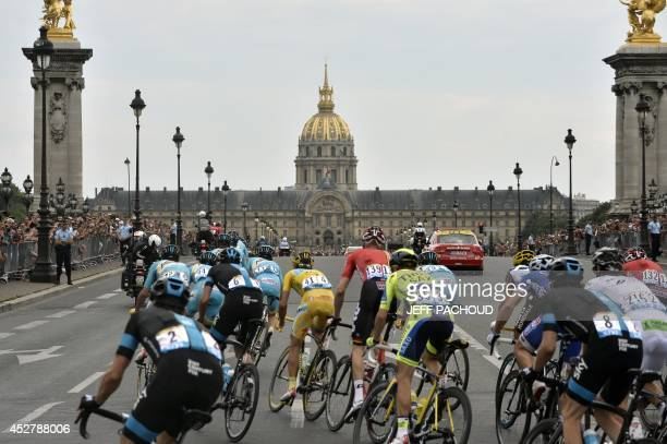 Italy's Vincenzo Nibali wearing the overall leader's yellow jersey rides in the pack in front of the Hotel des Invalides during the 1375 km...