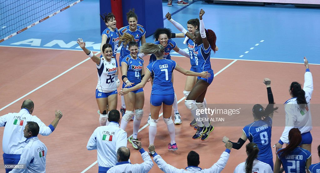 Italy's volleyball team celebrates after winning a match 3 sets to 2 against Belgium during the Women's European Olympic Qualification tournament for...