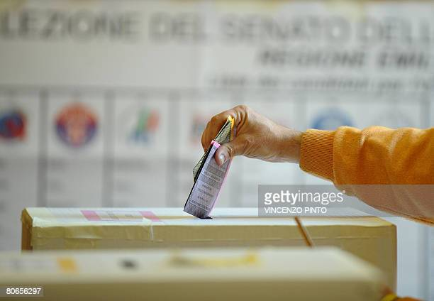 Italy's voter casts their ballots at a polling station in Bologna on April 13 2008 Italians began voting in general elections likely to usher...