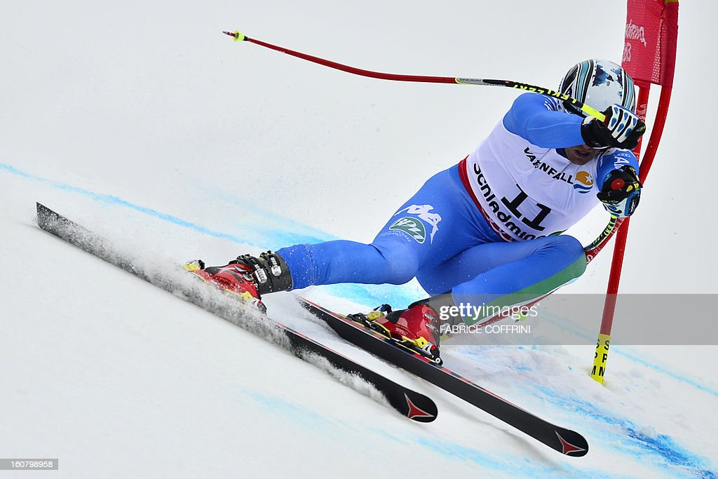 Italy's Werner Heel competes during the men's Super-G event of the 2013 Ski World Championships in Schladming, Austria on February 6, 2013. AFP PHOTO / FABRICE COFFRINI