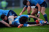 Italy's wing Luke McLean clears the ball during the Six Nations International Rugby Union match between Italy and Ireland at the Olympic Stadium in...