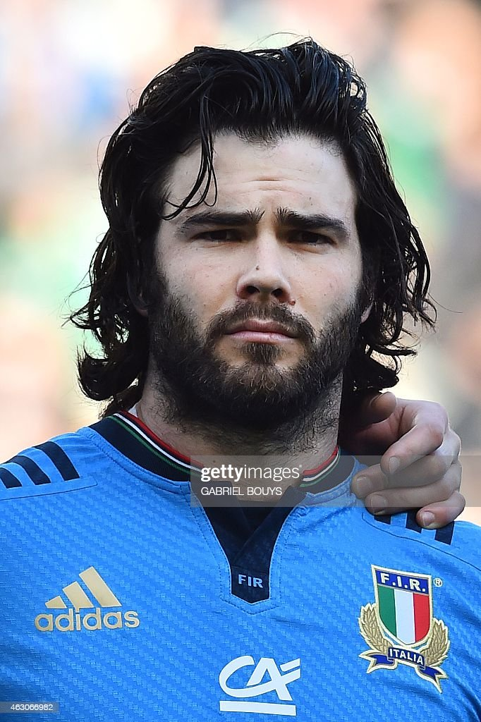 Italy's wing <a gi-track='captionPersonalityLinkClicked' href=/galleries/search?phrase=Luke+McLean&family=editorial&specificpeople=5700811 ng-click='$event.stopPropagation()'>Luke McLean</a> listens to the national anthems prior to the Six Nations international rugby union match between Italy and Ireland on February 7, 2015 in Rome. AFP PHOTO / GABRIEL BOUYS