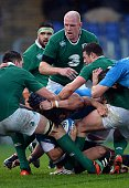 Italy's wing Luke McLean protects the ball during the Six Nations International Rugby Union match between Italy and Ireland at the Olympic Stadium in...