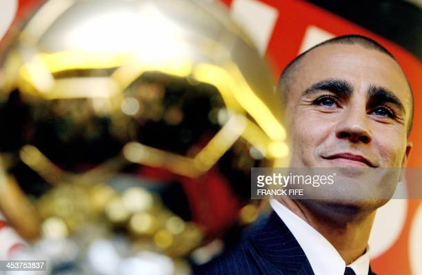 Italy's World Cupwinning captain Fabio Cannavaro poses next to his trophy after being awarded the 2006 'Ballon d'Or' for best football player of the...