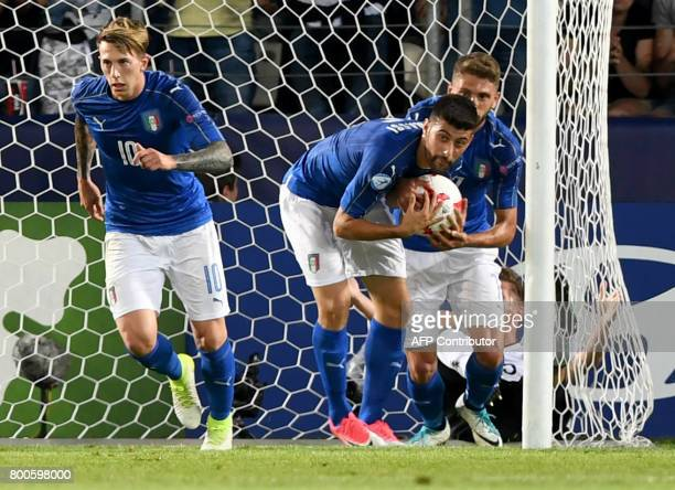 Italy's's Federico Bernardeschi Italy's midfielder Marco Benassi and Italy's defender Daniele Rugani react after Bernardeschi scored a goal during...