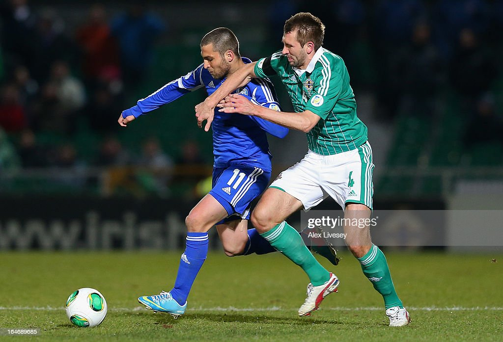 <a gi-track='captionPersonalityLinkClicked' href=/galleries/search?phrase=Itay+Shechter&family=editorial&specificpeople=5639928 ng-click='$event.stopPropagation()'>Itay Shechter</a> of Israel holds off a challenge from Gareth McAuley of Northern Ireland during the FIFA 2014 World Cup Group F Qualifier match between Northern Ireland and Israel at Windsor Park on March 26, 2013 in Belfast, Northern Ireland.