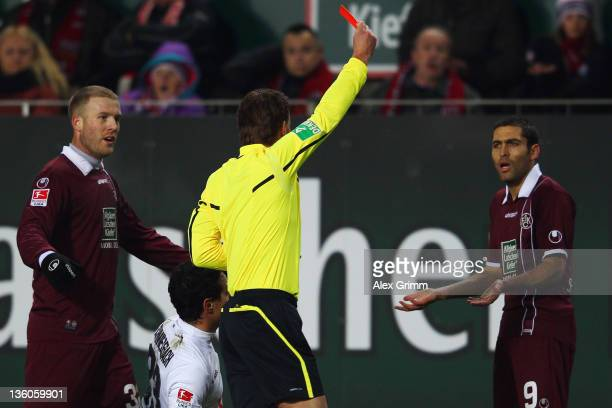 Itay Shechter of Kaiserslautern is sent off by referee Felix Brych during the Bundesliga match between 1 FC Kaiserslautern and Hannover 96 at...
