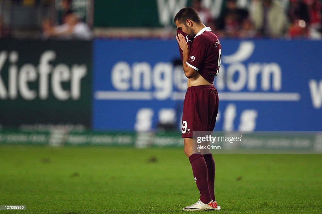 <a gi-track='captionPersonalityLinkClicked' href=/galleries/search?phrase=Itay+Shechter&family=editorial&specificpeople=5639928 ng-click='$event.stopPropagation()'>Itay Shechter</a> of Kaiserslautern reacts after missing a chance during the Bundesliga match between between 1. FC Kaiserslautern and VfB Stuttgart at Fritz-Walter Stadium on September 30, 2011 in Kaiserslautern, Germany.