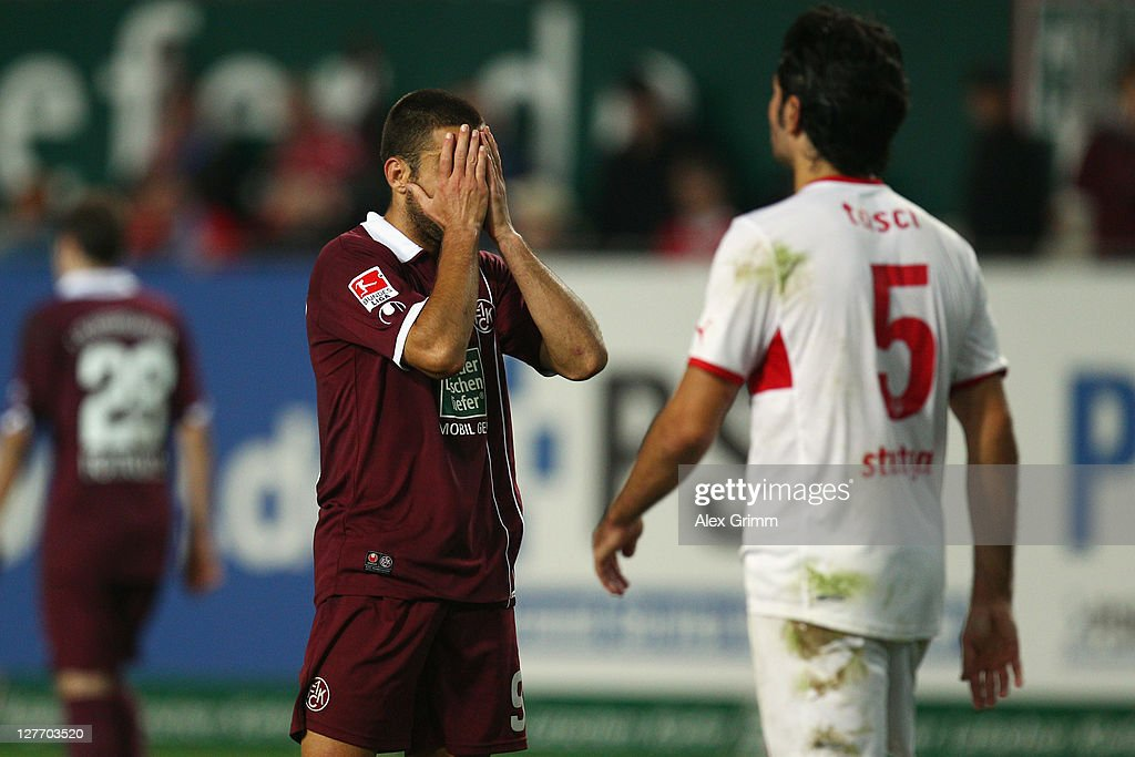 <a gi-track='captionPersonalityLinkClicked' href=/galleries/search?phrase=Itay+Shechter&family=editorial&specificpeople=5639928 ng-click='$event.stopPropagation()'>Itay Shechter</a> (L) of Kaiserslautern reacts after missing a chance during the Bundesliga match between between 1. FC Kaiserslautern and VfB Stuttgart at Fritz-Walter Stadium on September 30, 2011 in Kaiserslautern, Germany.