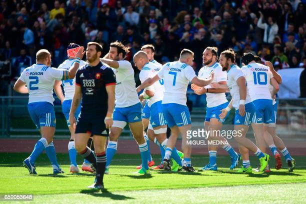 Itay's players celebrate after scoring during the International Six Nations rugby union match Italy vs France on March 11 2017 at the Olympic Stadium...