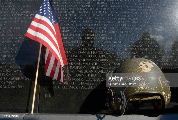 TOPSHOT Items are left at the Vietnam Veterans Memorial Wall in Washington DC on Veterans Day November 11 2016 in Washington DC / AFP PHOTO / Olivier...