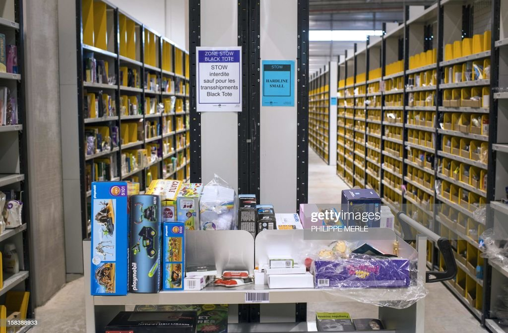 Items are pictured on December 13, 2012 at the site of the online retailer Amazon in Chalon-sur-Saone, centraleastern France. AFP PHOTO PHILIPPE MERLE