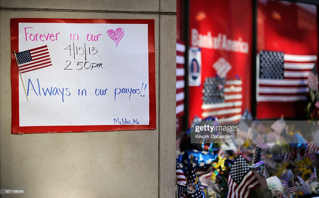 Items are placed by people visiting a makeshift memorial for victims near the finish line of the Boston Marathon bombings at the intersection of Boylston Street and Berkley Street two days after the second suspect was captured on April 21, 2013 in Boston, Massachusetts. A manhunt for Dzhokhar A. Tsarnaev, 19, a suspect in the Boston Marathon bombing ended after he was apprehended on a boat parked on a residential property in Watertown, Massachusetts. His brother Tamerlan Tsarnaev, 26, the other suspect, was shot and killed after a car chase and shootout with police. The bombing, on April 15 at the finish line of the marathon, killed three people and wounded at least 170.