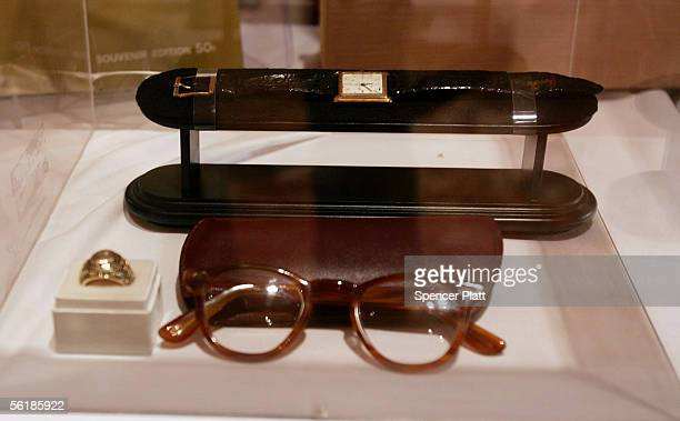 Items belonging to former US President John F Kennedy including reading glasses and a Omega watch worn at his inauguration lie on display at an...