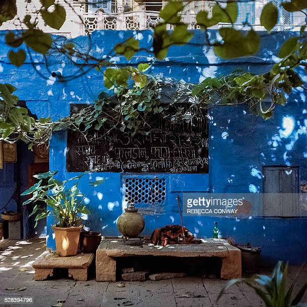 Items belonging to Indian Hindu devotees sit inside the courtyard of a temple in Jodhpur on April 15 2016 Rajasthan's 'Blue City' Jodhpur is famed...