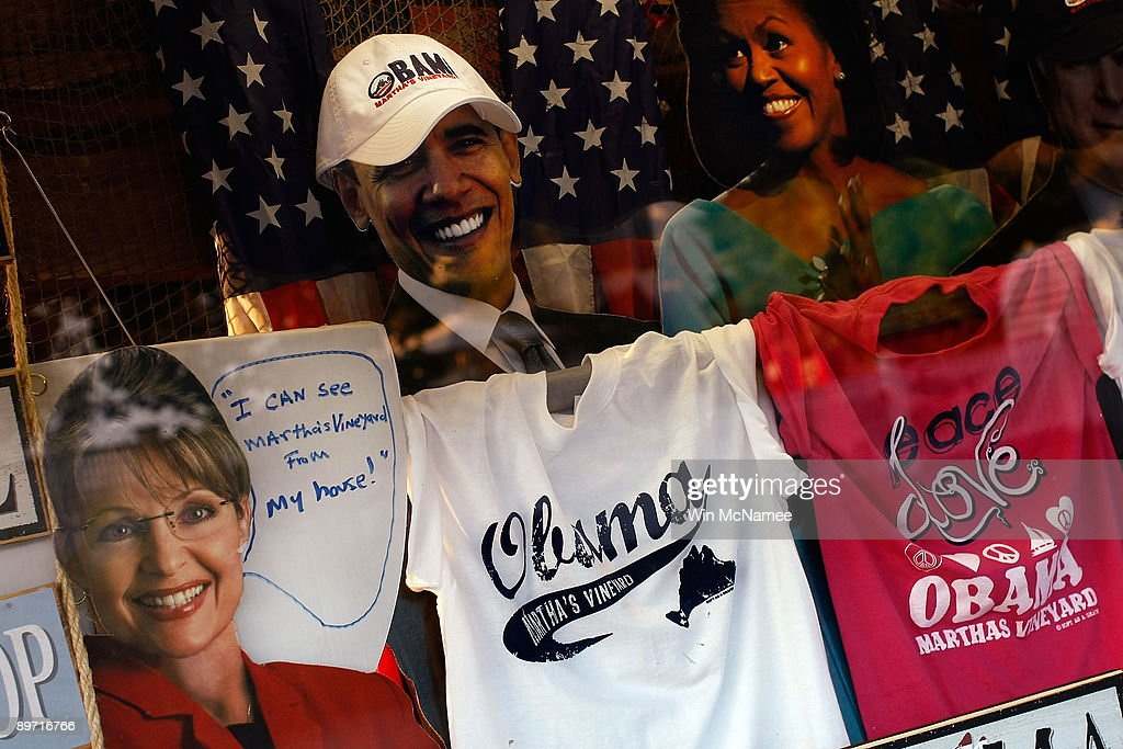 Items featuring U.S. President Barack Obama, his wife Michelle Obama, former Alaska Gov. Sarah Palin, and Sen. John McCain (R-AZ) are displayed in the window of the Soft As A Grape store August 8, 2009 in Edgartown, Massachusetts on the island of Martha's Vineyard. President Barack Obama and his family will visit Martha's Vineyard and stay at the Blue Heron Farm off South Road in Chilmark while on vacation during the last week of August.