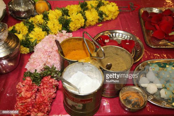 Items for prayers rest on a table by a shrine as Tamil Hindu priests perform special prayers honouring Lord Murugan during a festival at a Tamil...