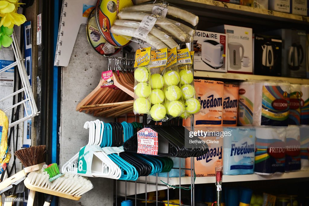A Items for sale outside a general store on St Johns Road, Clapham on September 24, 2013 in London, England. The Labour leader Ed Miliband in his party conference speech has pledged to help small firms by freezing business rates in England. The high street has becoming increasingly full of betting shops, charity shops and pawn brokers replacing independent shops.