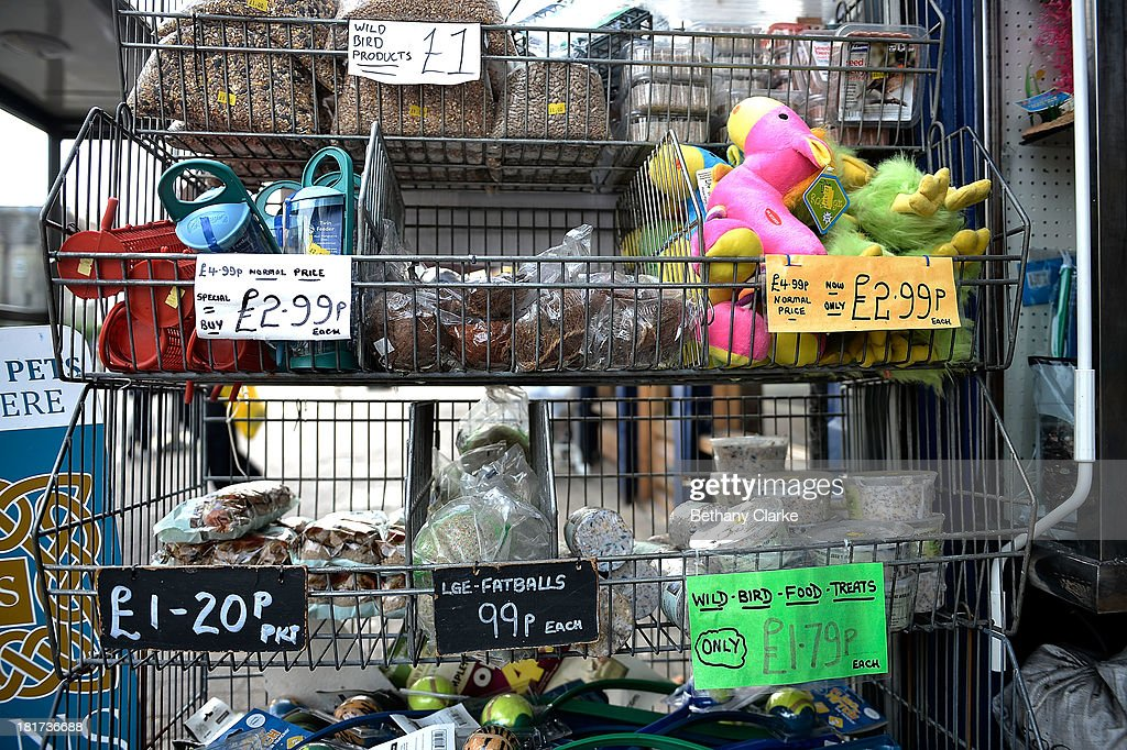 Items for sale outside a pet shop on St Johns Road in Clapham September 24, 2013 in London, England. The Labour leader Ed Miliband in his party conference speech has pledged to help small firms by freezing business rates in England. The high street has becoming increasingly full of betting shops, charity shops and pawn brokers replacing independent shops.
