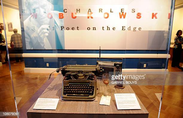 Items from Charles Bukowski's desk are on display during the media preview of the exhibition 'Charles Bukowski poet on the edge' at the Huntington...