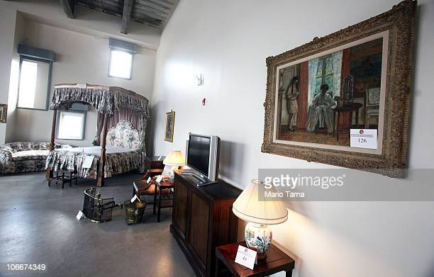 Items including a bed are displayed at a press preview of an auction of 400 pieces of personal property jewelry and antiques from Bernard and Ruth...