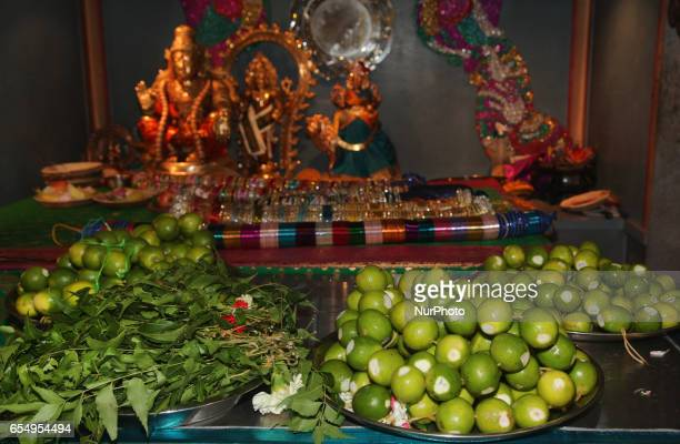 Items rest on a table in the temple ready to be used to adorn the deities in green during the Mahotsava Festival at a Hindu temple in Ontario Canada...