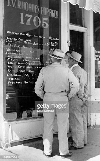 Itenerants study job advertisements in the window of a market street employment agency the agency charges days a wages or five per cent of a monthly...