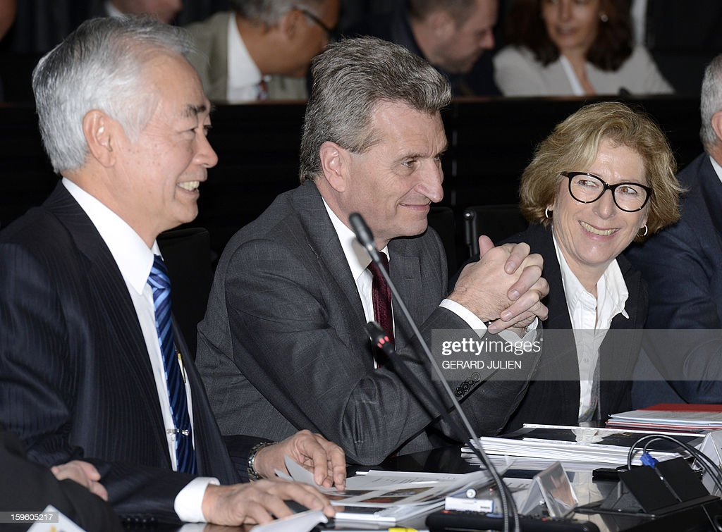 Iter organization's general director Osamu Motojima (L) sits next to Guenther Oettinger (L), EU Commissioner for Energy and French minister for Higher Education and Research Genevieve Fioraso (R) during the inauguration of the International Thermonuclear Experimental Reactor (Iter) Organization headquarters on January 17, 2013 in Saint-Paul-lez-Durance, southern France. The International Thermonuclear Experimental Reactor (Iter), based at the French Atomic Energy Commission (CEA) research center of Cadarache in Saint-Paul-lès-Durance, was set up by the EU, which has a 45 percent share, China, India, South Korea, Japan, Russia and the US to research a clean and limitless alternative to dwindling fossil fuel reserves.