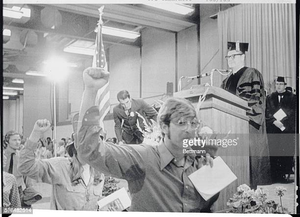 Radical students walk out with clenched fists during Governor Nelson Rockefeller's commencement address at Ithaca College's Ben Light gymnasium Many...