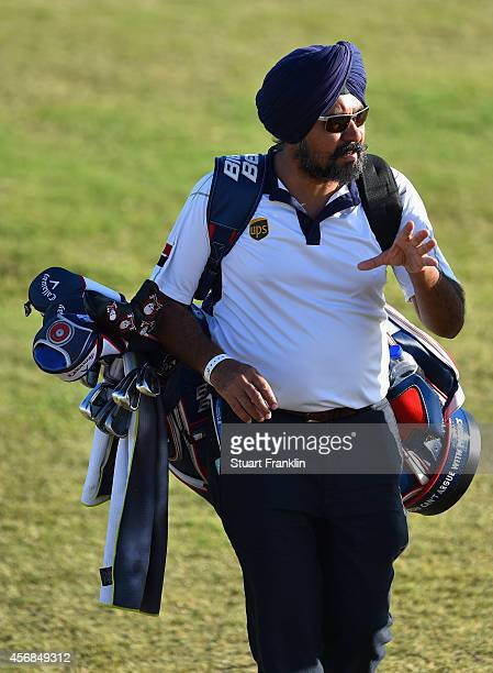 itinder Singh swing coach to Jeev Milkha Singh of India carrys his golf bag during the pro am prior to the start of the Portugal masters at Oceanico...