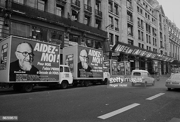 Itinerant billboards of the campaign of abbot Pierre organised with the aid of 'FranceSoir' for Christmas in front of the newspaper's head office...