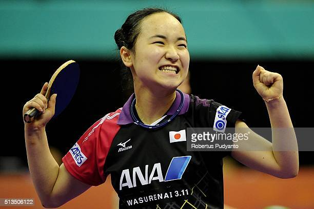 Ito Mima of Japan reacts after beating Sabine Winter of Germany during the 2016 World Table Tennis Championship Women's Team Division quarterfinal...