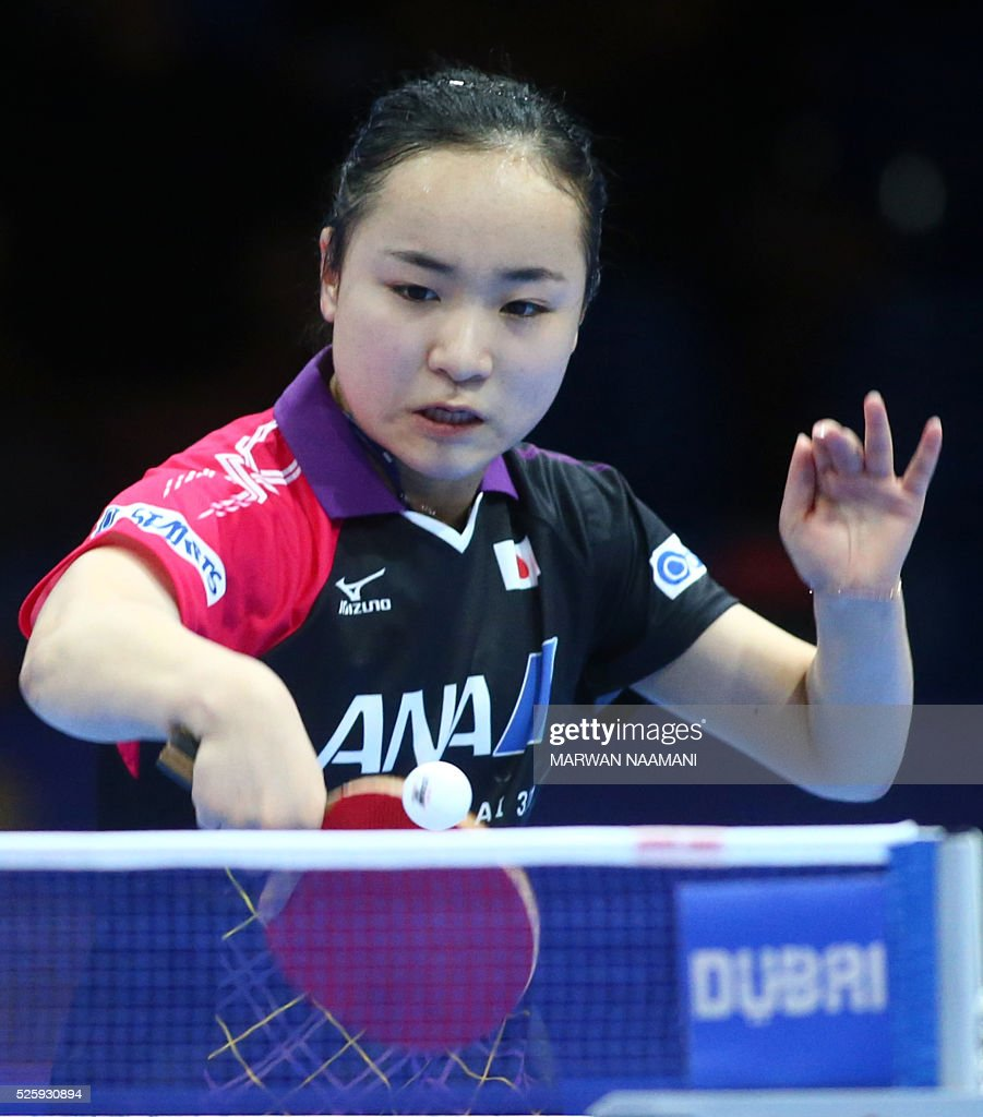 Ito Mima of Japan returns the ball to Liu Shiwen of China during their women's singles quarter final table tennis match in the ITTF Nakheel Table Tennis Asian Cup, on April 29, 2016 in Dubai. / AFP / MARWAN