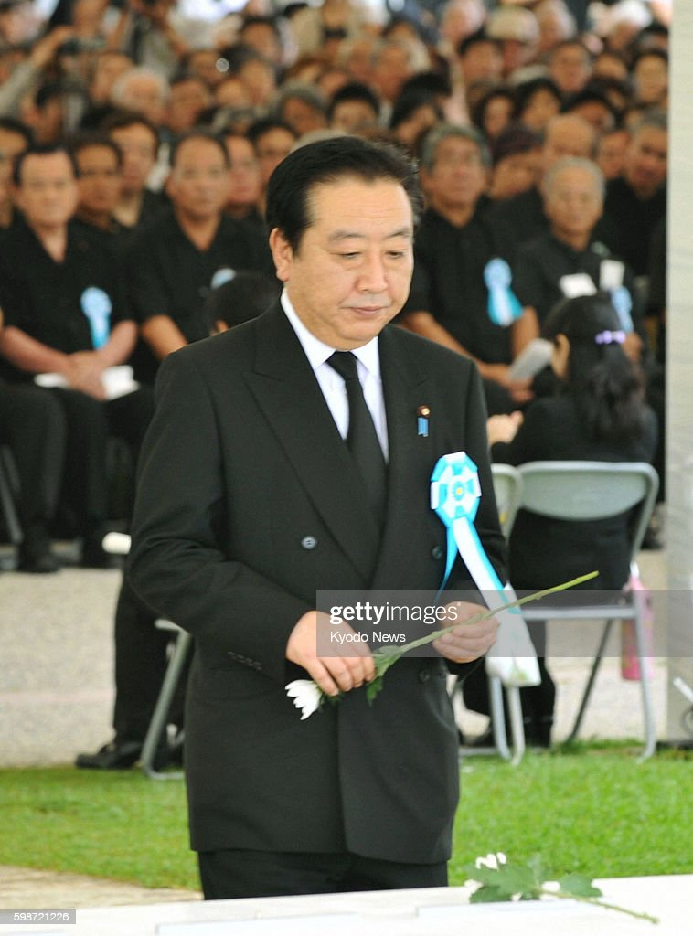 Itoman Japan Japanese Prime Minister Yoshihiko Noda offers a flower during a ceremony in Itoman Okinawa Prefecture on June 23 marking the 67th...