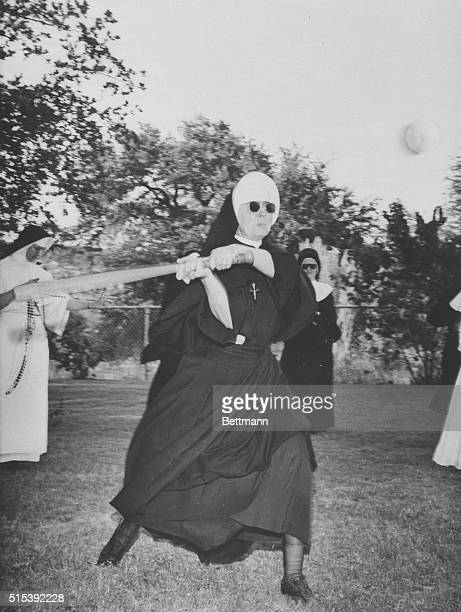 It's a big change of pace for Sister Magdalene SSCJ of San Antonio Tex as she steps in determinedly to slam the ball in a ball game at the Davenport...