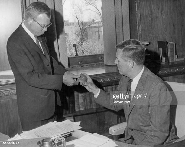 It's A Core Of Course A polished oil well core was presented to Gov John Love right in connection with the 50th anniversary of the American...