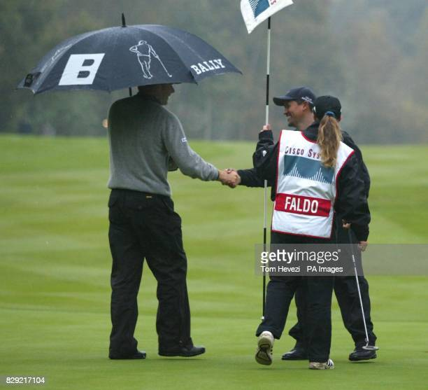 It's all over on the 43rd hole as Nick Faldo shakes the hand of Michael Campbell who won his 1st round match in The Cisco World Matchplay * The match...