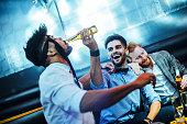 Group of young men having fun at a bar