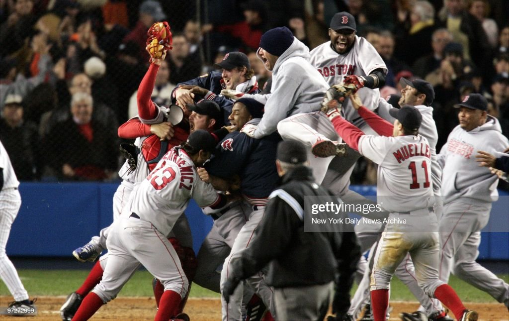 It's bedlam but a happy kind as Boston Red Sox players explode with joy after their 103 victory over the New York Yankees in Game 7 of the American...