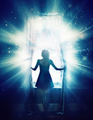 Illustration of a woman opening a window to brilliant glowing light